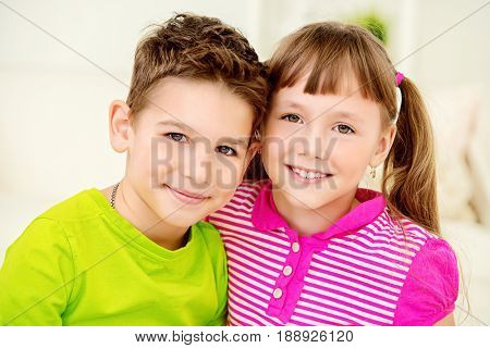 Portrait of happy joyful children at home. Family concept.