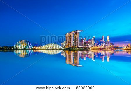 SINGAPORE-JULY 9, 2016: Landscape of Singapore Skyline and view of skyscrapers on Marina Bay at sunset time, The most famous tourist attraction in Singapore.