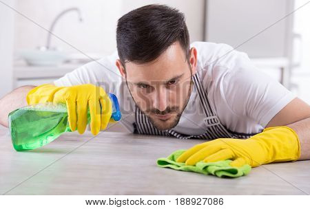 Man Wiping Kitchen Table