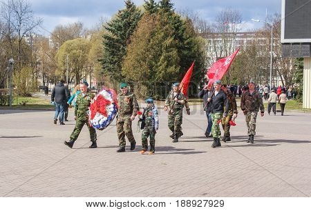 Kirishi, Russia - 9 May, A paramilitary group with flags and a wreath, 9 May, 2017. Preparation and conduct of the action Immortal regiment in small cities of Russia.
