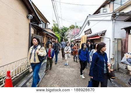 Kyoto Japan - April 9 2016 : People walking to appreciate the beauty of nature in Arashiyama bamboo forest Kyoto Japan