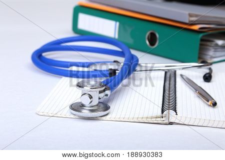 Folder file, stethoscope and RX prescription on the desk. blurred background