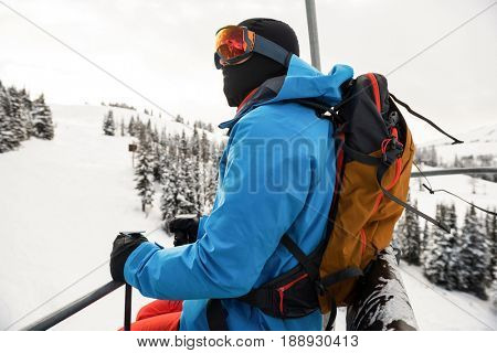 Side view of skier looking at beautiful snow-covered mountains