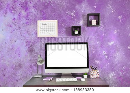 Lilac color accent in modern interior. Creative workplace with computer at home