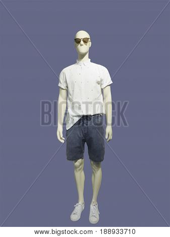 Full-length male mannequin dressed in casual summer clothes isolated. No brand names or copyright objects.