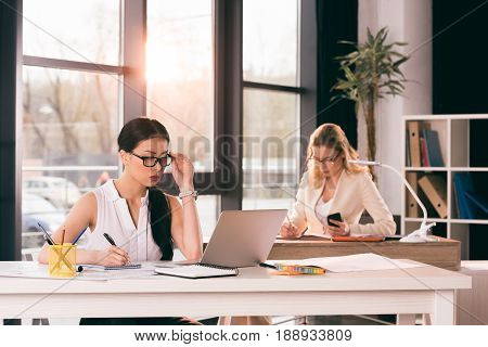 Young Multiethnic Businesswomen In Formalwear Working At Modern Office