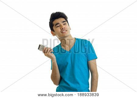 beautiful awesome guy in the blue shirt holding a shaving machine and raised my head isolated on white background