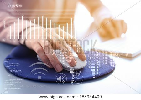 Concept of business analytics and modern technology. Woman using mouse for work with computer, closeup