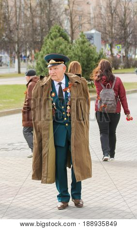 Kirishi, Russia - 9 May, A veteran in a raincoat, 9 May, 2017. Preparation and conduct of the action Immortal regiment in small cities of Russia.
