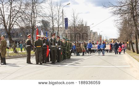 Kirishi, Russia - 9 May, Building a column on the avenue, 9 May, 2017. Preparation and conduct of the action Immortal regiment in small cities of Russia.