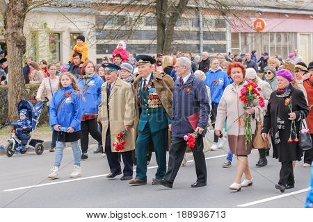 Kirishi, Russia - 9 May, Different people shares an immortal regiment, 9 May, 2017. Preparation and conduct of the action Immortal regiment in small cities of Russia.