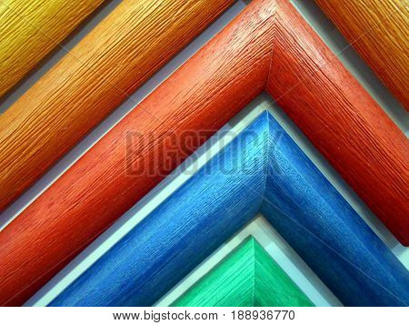 samples of coloured wooden frames picture framing and mirrors