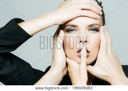 girl face and hands that make different beauty salon service female face and many hands making makeup and hairdress design for beauty salons and beauty industry on grey background