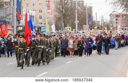 Kirishi, Russia - 9 May, The crowd of people in the action immortal regiment, 9 May, 2017. Preparation and conduct of the action Immortal regiment in small cities of Russia.