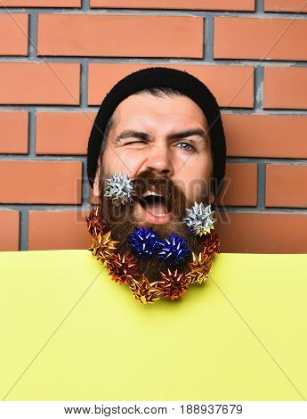 Bearded Man, Brutal Caucasian Squinting Hipster With Gift Decoration Stars