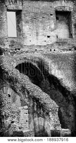 Rome Italy - June 10 2016: Interior walls of the Colosseum in Rome. Walls are built of concrete and sand and once served as an amphitheatre.