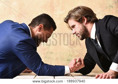 loser man shouting arm wrestling defeat and victory of businessman in suit