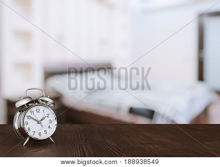 clock on wooden table in the bedroom