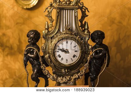 A dial of an old antique clock, a vintage background. Concepts of antiques and time