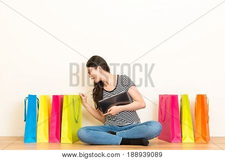 Elegant Woman Looking At Shopping Bags Checking