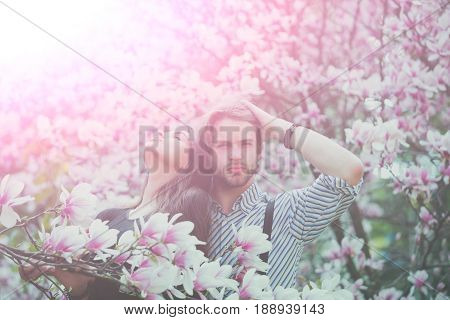 Man And Pretty Girl Enjoying Magnolia Flower Blossom