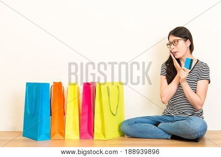 Young Woman Shopping Online Through Credit Card