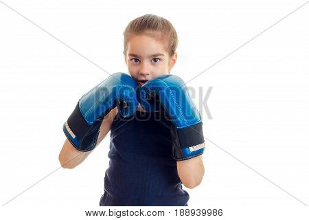 cute little girl holding a near person hands in boxing gloves is isolated on a white background close-up