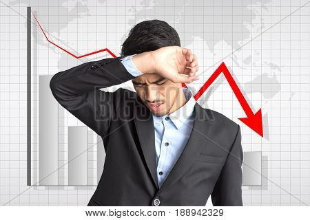 Usiness Man Preocupied Over A Graph Background
