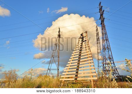 Power line in river lighthouse on the outskirts of St. Petersburg Russia.