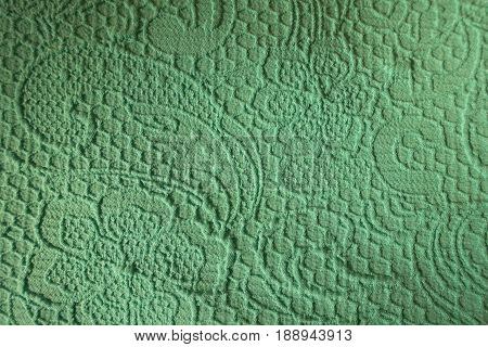 Relief Squiggles And Flowers On The Turquoise Fabric