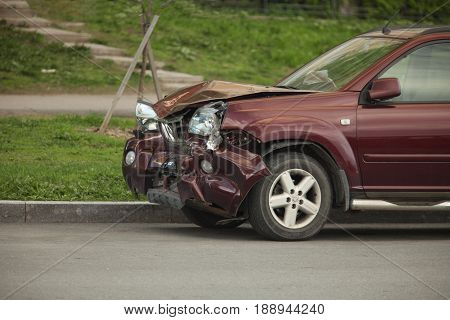 Car crash after a head-on collision on the roadside