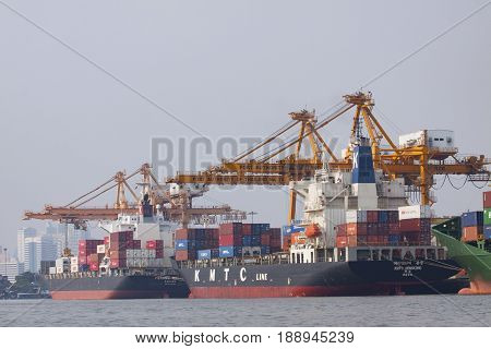 KLONG TUEY BANGKOK THAILAND - JANUARY 25 2015 : large commercial ship loading container box to klong tuey port chao praya river important logistic line in heart of thailand capital