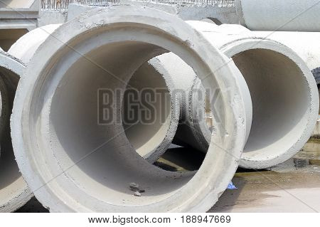 concrete drainage pipes on concrete floor for industrial building construction.
