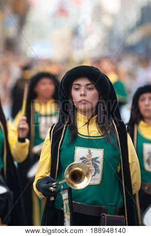 Asti, Italy - September 19, 2010: the historic Medieval parade of the Palio of Asti in Piedmont, Italy. Trumpet girl, Reenactment in medieval costumes