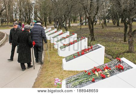 Kirishi, Russia - 9 May, Older people pass by memorable plates, 9 May, 2017. Laying wreaths and flowers in memory of the fallen at the Eternal Flame.