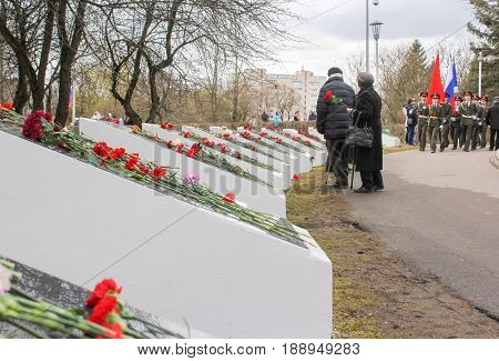 Kirishi, Russia - 9 May, Memorable plates along the path, 9 May, 2017. Laying wreaths and flowers in memory of the fallen at the Eternal Flame.