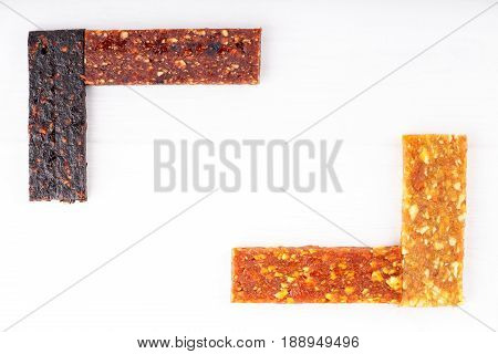 Fruit berry and nut energy bars. Healthy snack. Frame