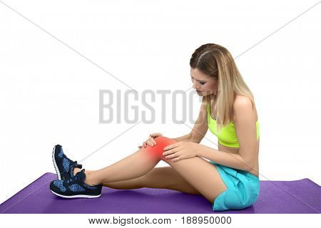 Concept of orthopedist. Woman suffering from pain in knee on white background