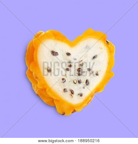 Heart shaped pitahaya on color background. Superfood concept