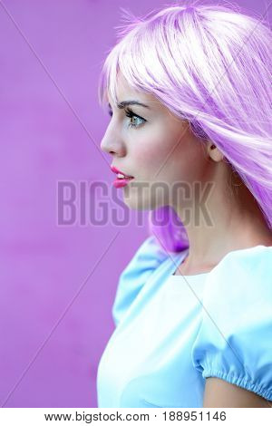 Trendy hairstyle ideas. Young woman with dyed lilac hair on color background