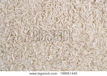Rice, white grains closeup. Basmati. Unpolished, uncooked, natural, diet, raw for traditional asian cuisine, dish. Popular agriculture cereal. Texture pattern background, copy space.