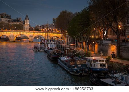 Paris, France, March 28 2017: Seine river in Paris at night,waterfront of the seine river in the city of Paris in france