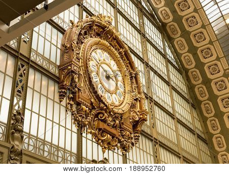 Paris, France, March 31 2017: Golden clock of the museum D'Orsay.The Musee d'Orsay is a museum in Paris, on the left bank of the Seine