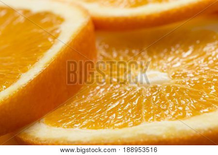 Close up of juicy orange fruit cross sections. Selective focus
