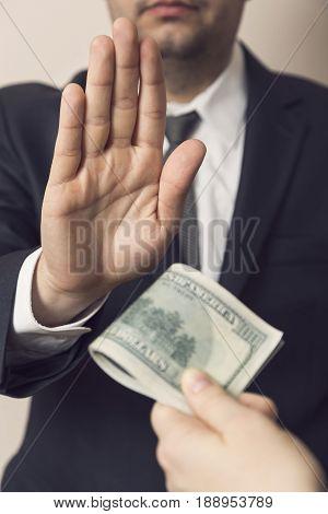 Detail of an honest businessman refusing a bribe money. Selective focus