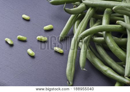 Group of fresh green bean on slate stone plate