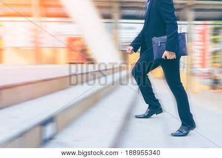 Businessman running up the stair blurred motion