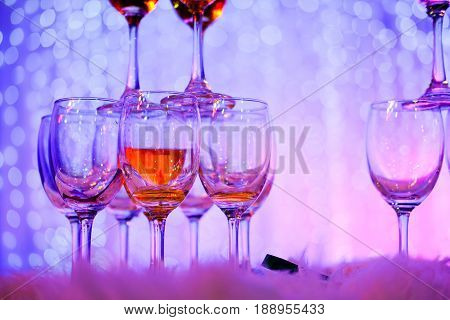 Champagne glasses in wedding ceremony. Tower of champagne glasses