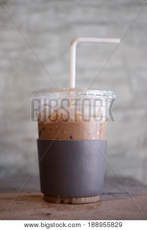 Iced cold cocoa coffee (mocha) with black paper cup holder