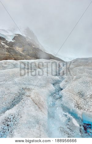 Stream Of Melted Snow On The Glacier Along The Icefields Parkway Between Banff And Jasper In The Can